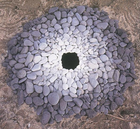Pebbles around a hole - sculpture by Andy Goldsworthy