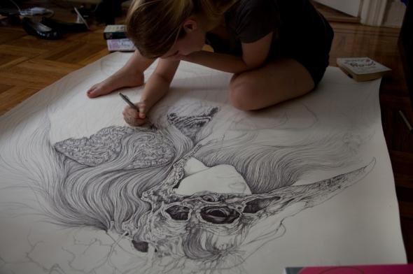 Caitlin Hackett drawing in her studio